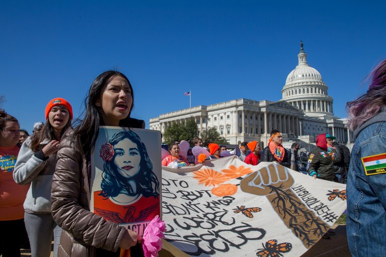 Students protesting the rescission of DACA in front of the U.S. capital.